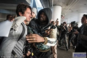 Photos: Kanye West Separates Two Fighting Photographers At LA Airport